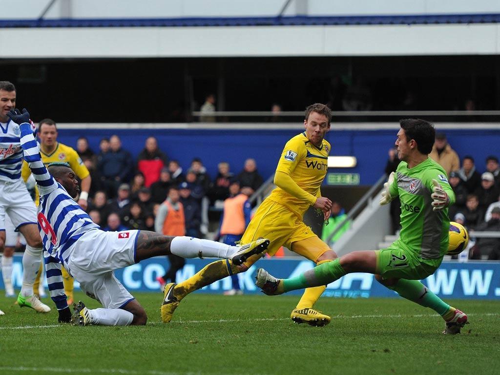 Queens Park Rangers striker Djibril Cisse scores their an equaliser past Reading goalkeeper Alex McCarthy