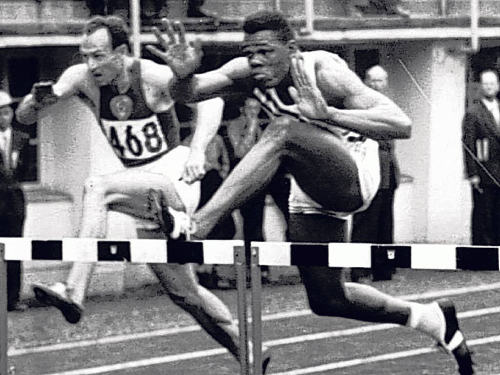 Campbell, left, in the decathlon 110m hurdles at the 1952 Olympics