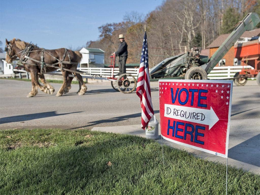 A farmer passes a polling station during election day in Becks Mill, Ohio