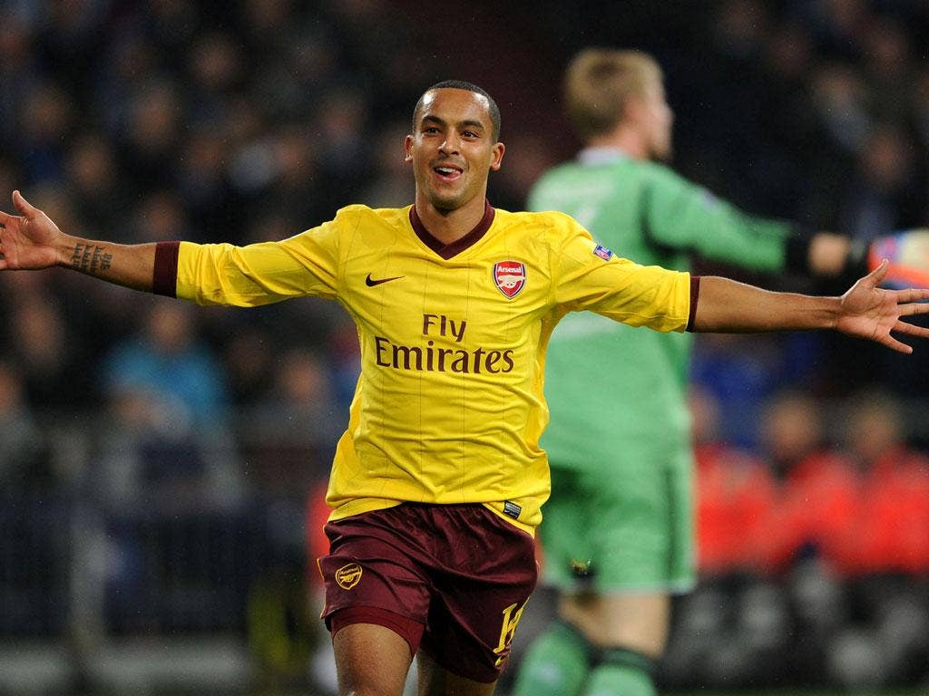Theo Walcott of Arsenal celebrates scoring his team's first goal