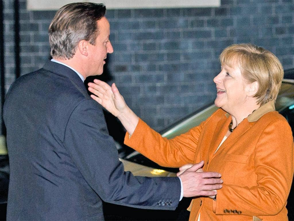 Angela Merkel is greeted by David Cameron at 10 Downing Street yesterday
