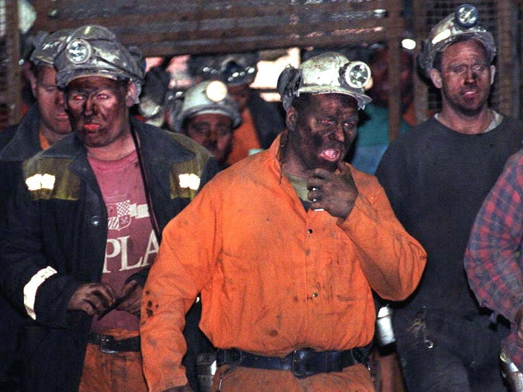 Coal Miners return to the surface after finishing a shift at Maltby