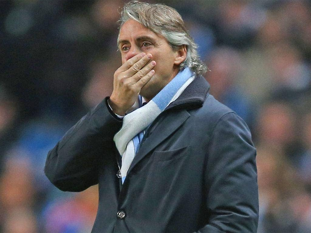 Roberto Mancini looks on during Manchester City's draw with Ajax