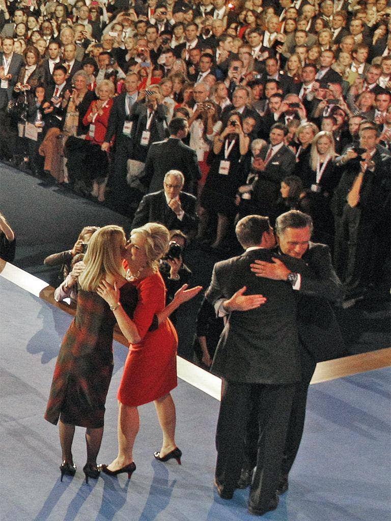 Mitt Romney and Paul Ryan, and their wives Ann and Janna, embrace after Mr Romney concedes defeat
