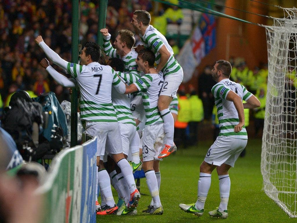 Victor Wanyama is mobbed by his Celtic team-mates