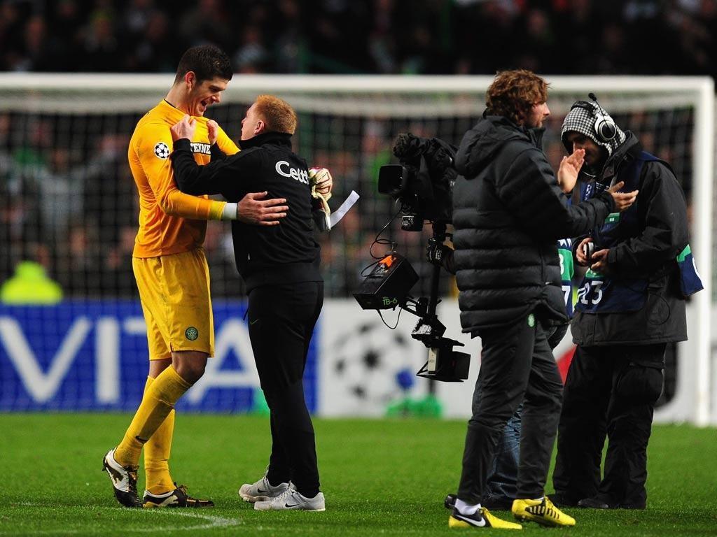 Celtic goalkeeper Fraser Forster celebrates with manager Neil Lennon