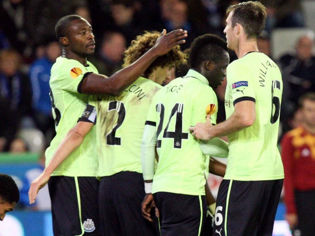 Shola Ameobi (left) celebrates with teammates after scoring his team's second goal