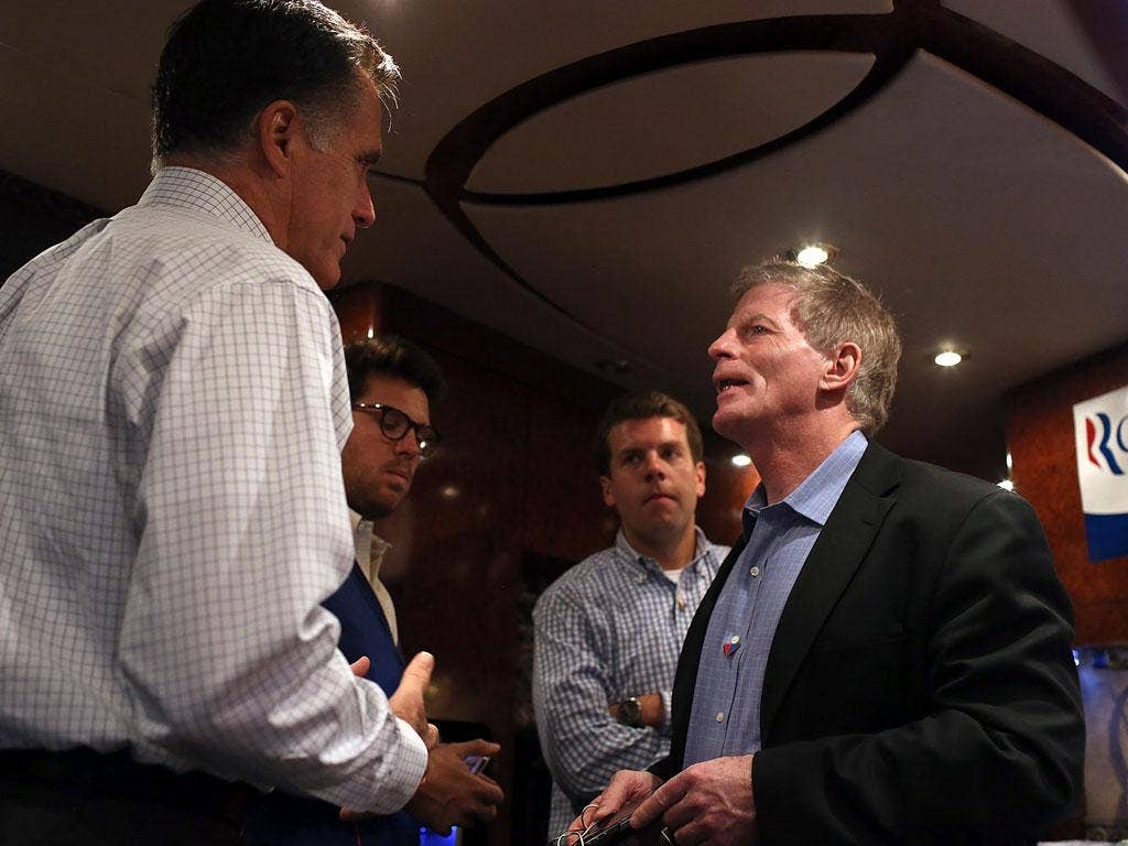 Mitt Romney with Stuart Stevens, one of his senior advisers, during the campaign