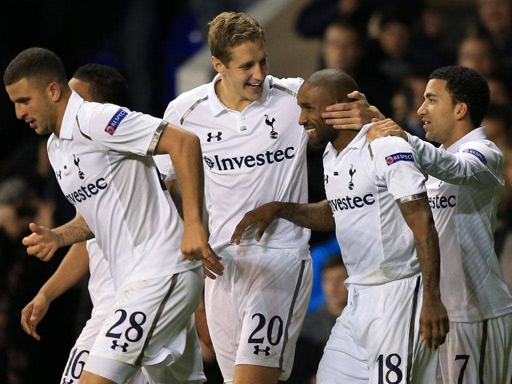 Jermain Defoe of Tottenham Hotspur celebrates scoring their second goal with Michael Dawson and Aaron Lennon - Defoe scored all three goals during the game