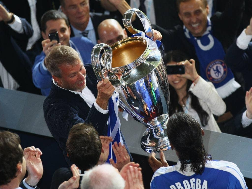 Roman Abramovich celebrates with the Champions League trophy