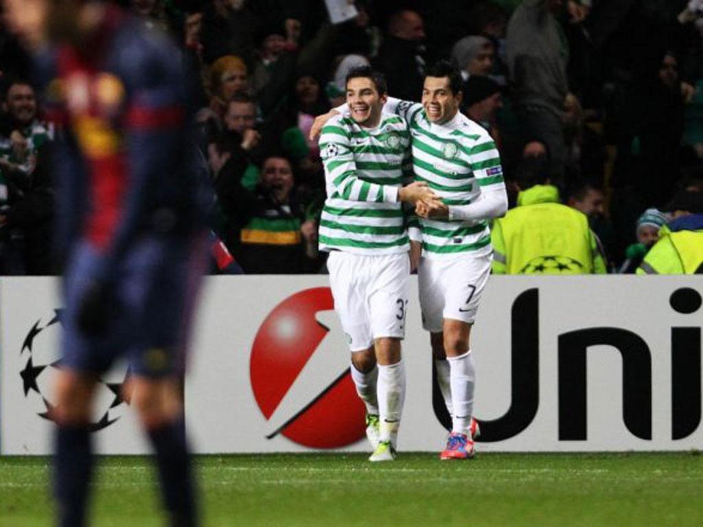 Celtic's Tony Watt (left) celebrates his winning goal against Barça
