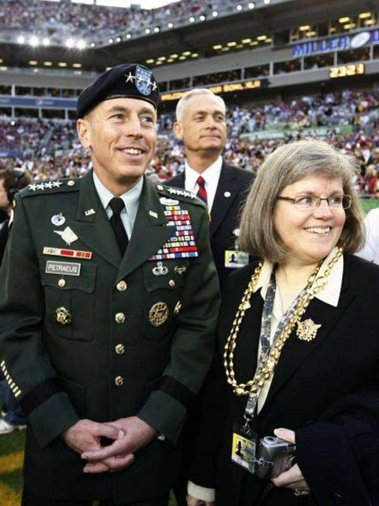 David Petraeus, seen with his wife Holly, said his extramarital affair was unacceptable conduct