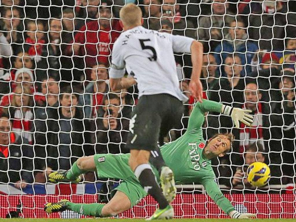 Mark Schwarzer of Fulham  saves the penalty of Mikel Arteta of Arsenal