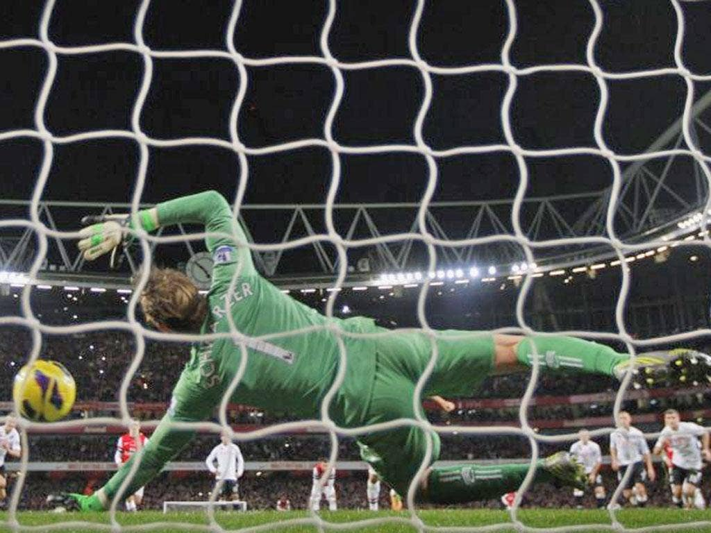 Fulham's Australian goalkeeper Mark Schwarzer saves the penalty taken by Arsenal's Spanish player Mikel Arteta