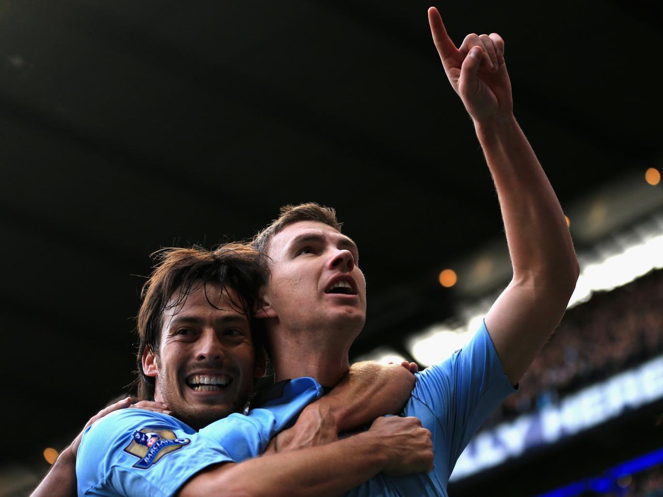 Manchester City's Edin Dzeko celebrates his goal against Spurs