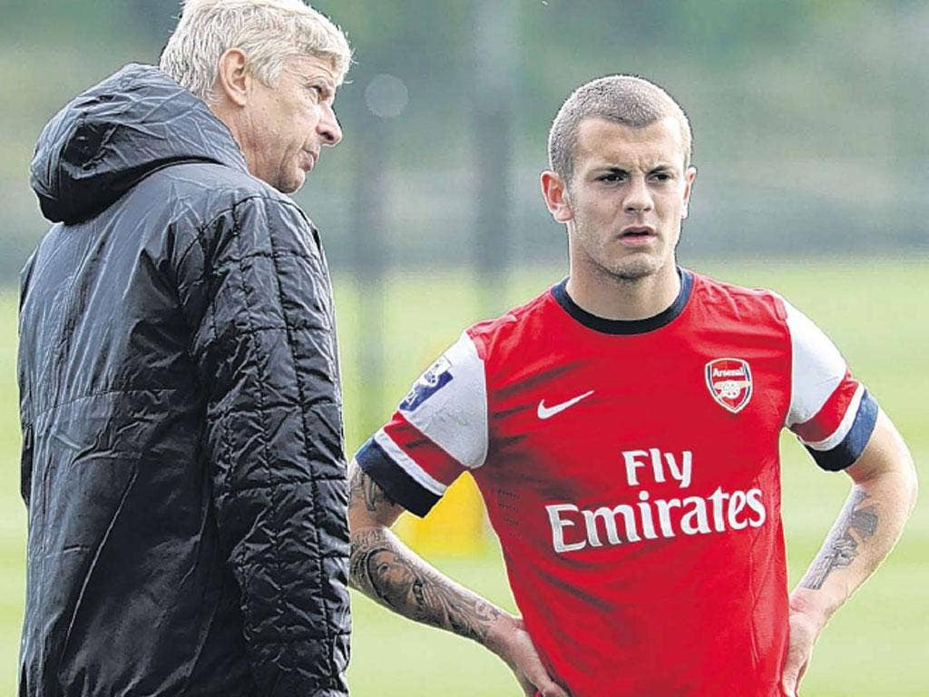 Arsène Wenger (left) is not happy about Jack Wilshere's call-up by England