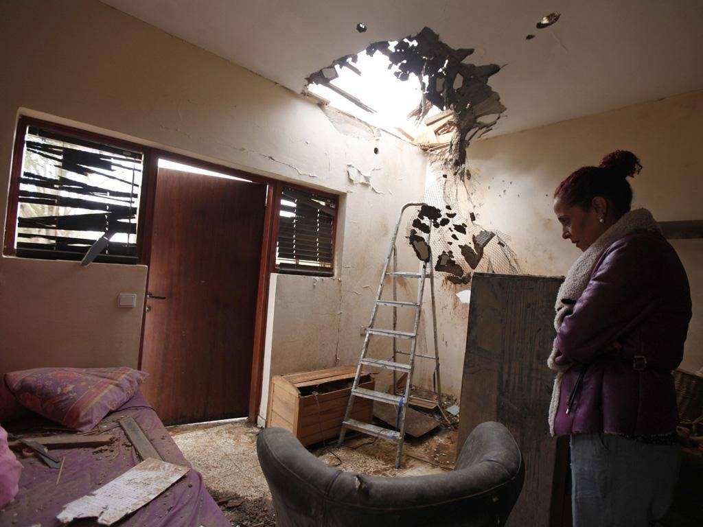 Tami Shadadi surveys the damage to her house in the southern town of Sderot