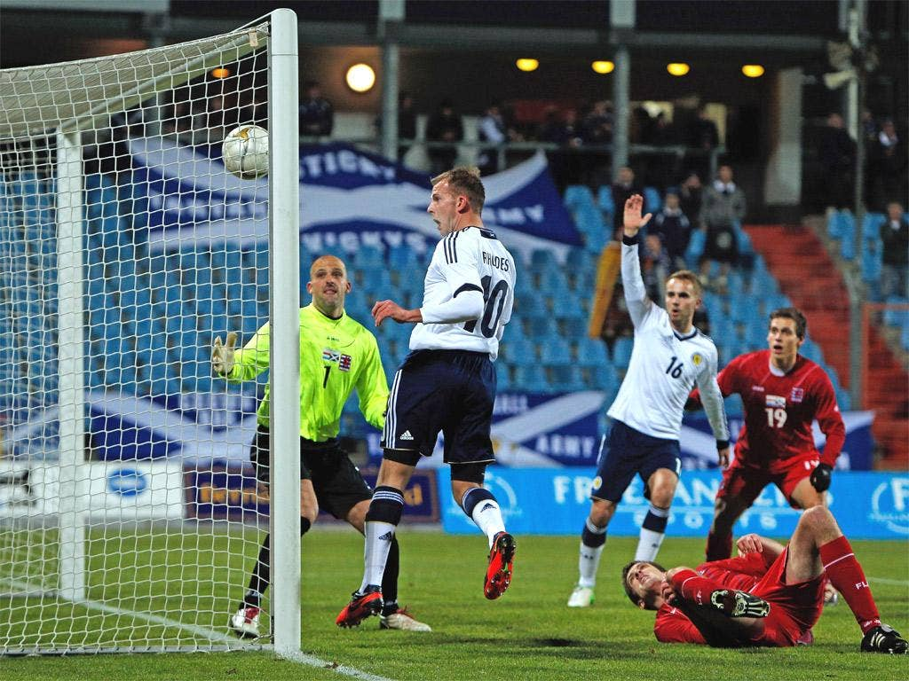 Jordan Rhodes heads in his opening goal for Scotland against Luxembourg