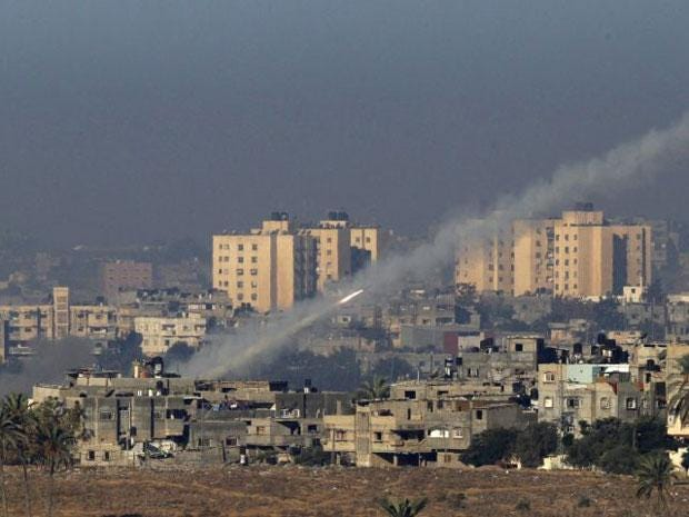 A rocket is seen after its launch from the northern Gaza Strip towards Israel  today