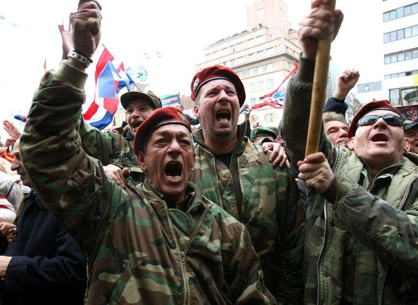 Croatian veterans cheer in Zagreb yesterday after UN appeal court judges quash the convictions of Mladen Markac