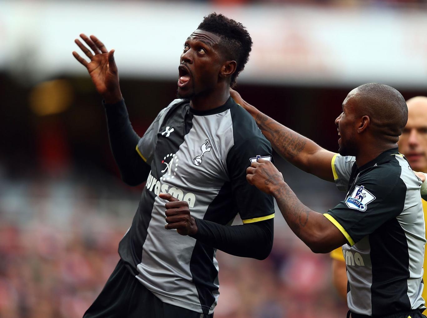 Emmanuel Adebayor celebrates his opener for Tottenham Hotspur against Arsenal