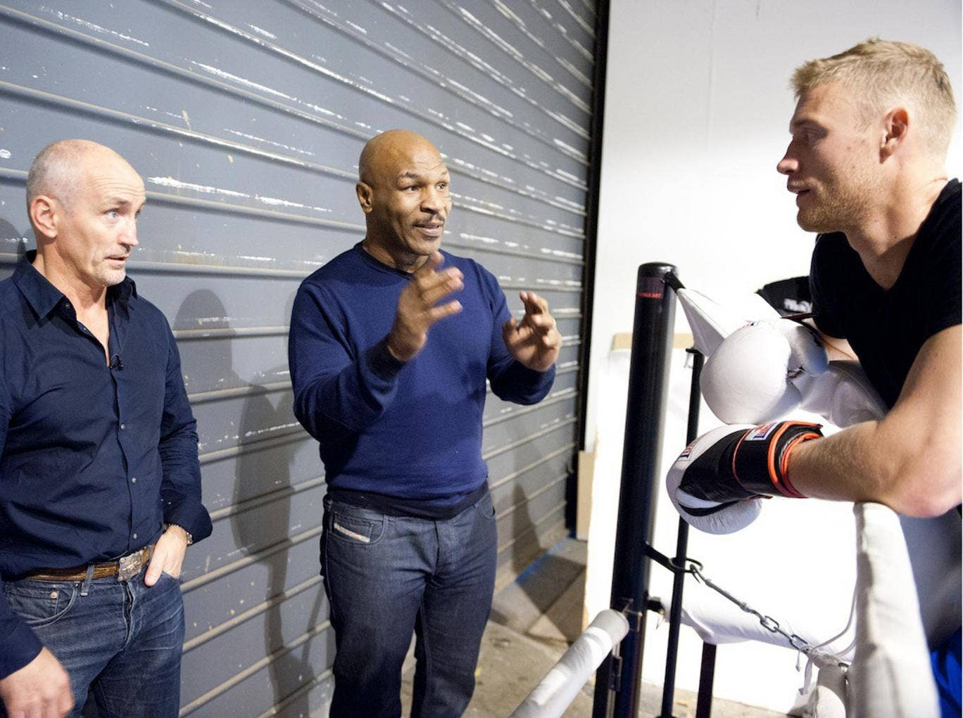 Ring the changes: Andrew Flintoff and his trainer Barry McGuigan (far left) receive some advice from Mike Tyson