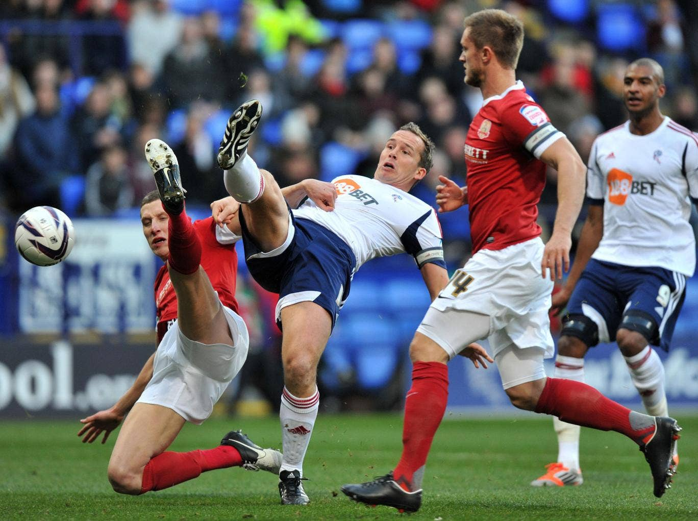 Leg up: Bolton's Kevin Davies challenges Barnsley's Jim McNulty for the ball