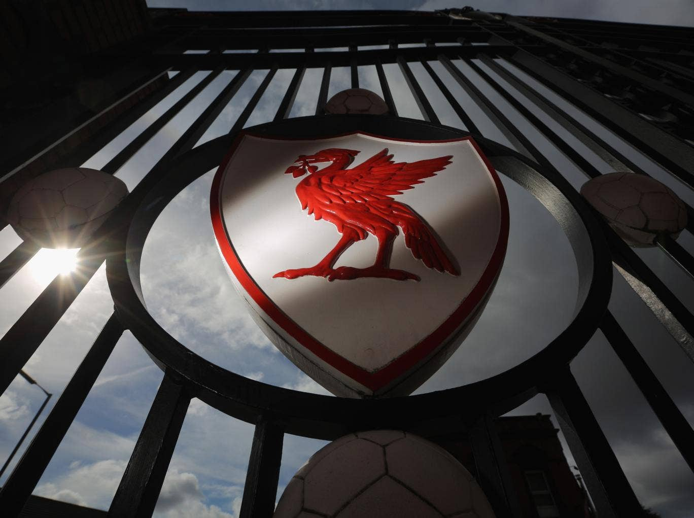Liverpool FC emblem on Anfield stadium's gates. Victims' families want inquiries to be 'knitted together'