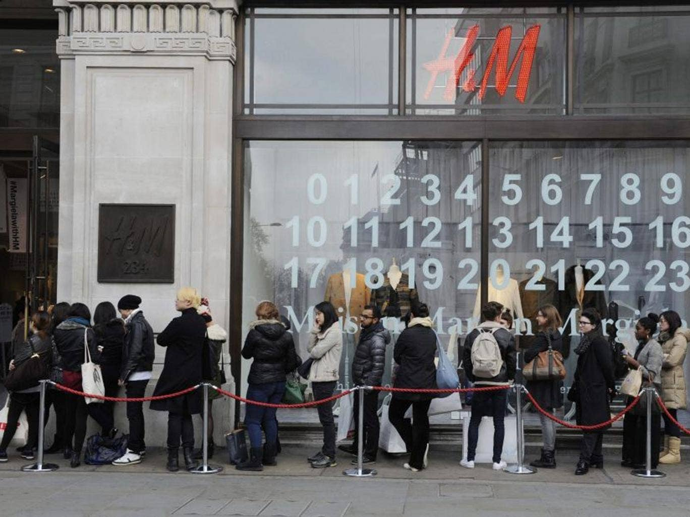 Shoppers queue outside an H&M store for the launch of Maison Martin Margiela's special collection