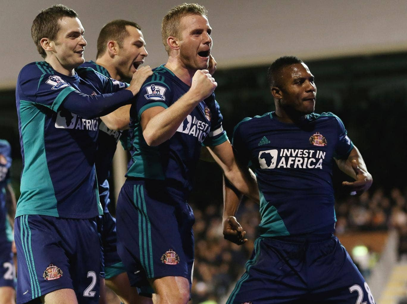 Stephane Sessegnon (far right) celebrates with his teammates