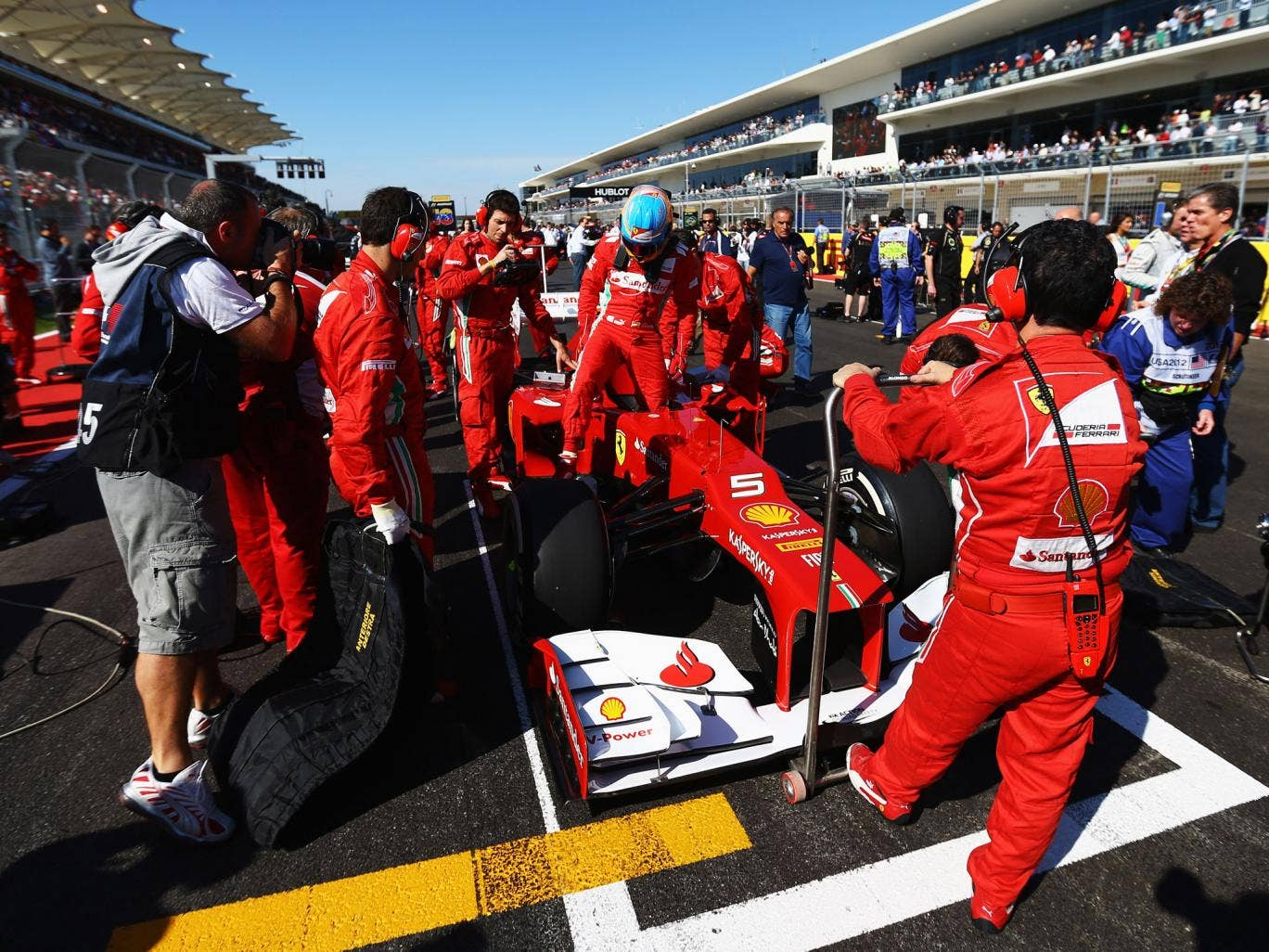 Fernando Alonso gets into his Ferrari ahead of the United States Formula One Grand Prix at the Circuit of the Americas