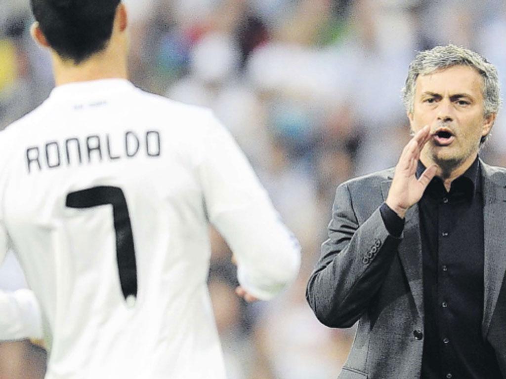 Jose Mourinho shouts instructions to Cristiano Ronaldo