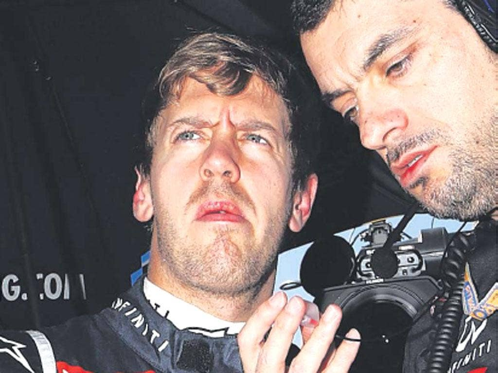 Sebastian Vettel consults his race engineer before yesterday's race