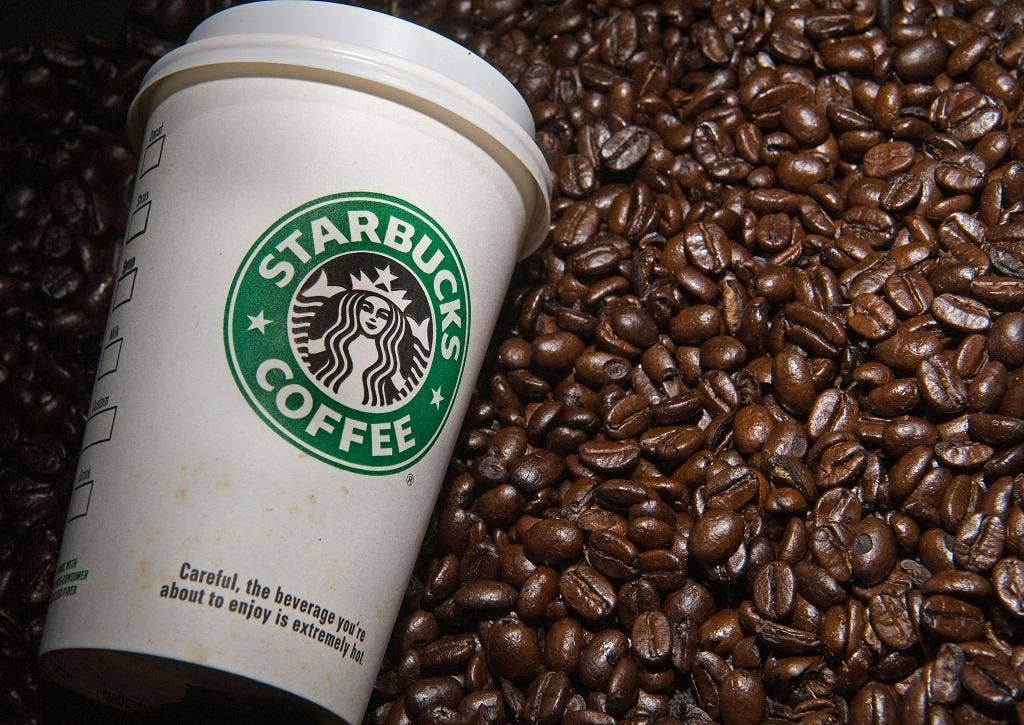 Starbucks has confirmed that it is in talks with the Government about paying more in UK taxes.
