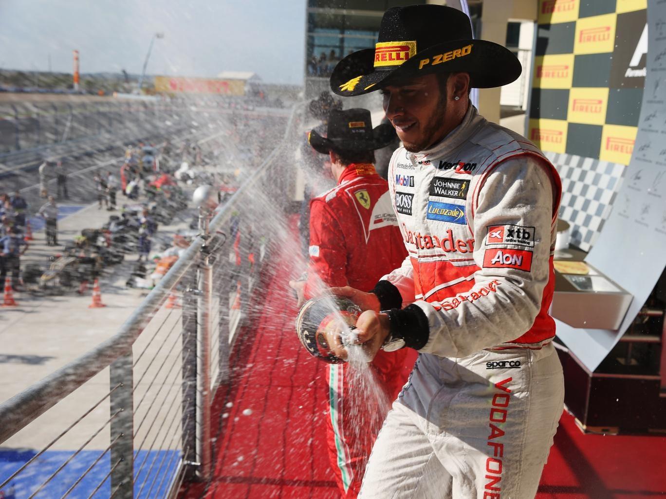 Lewis Hamilton celebrates on the podium after winning the United States Formula One Grand Prix