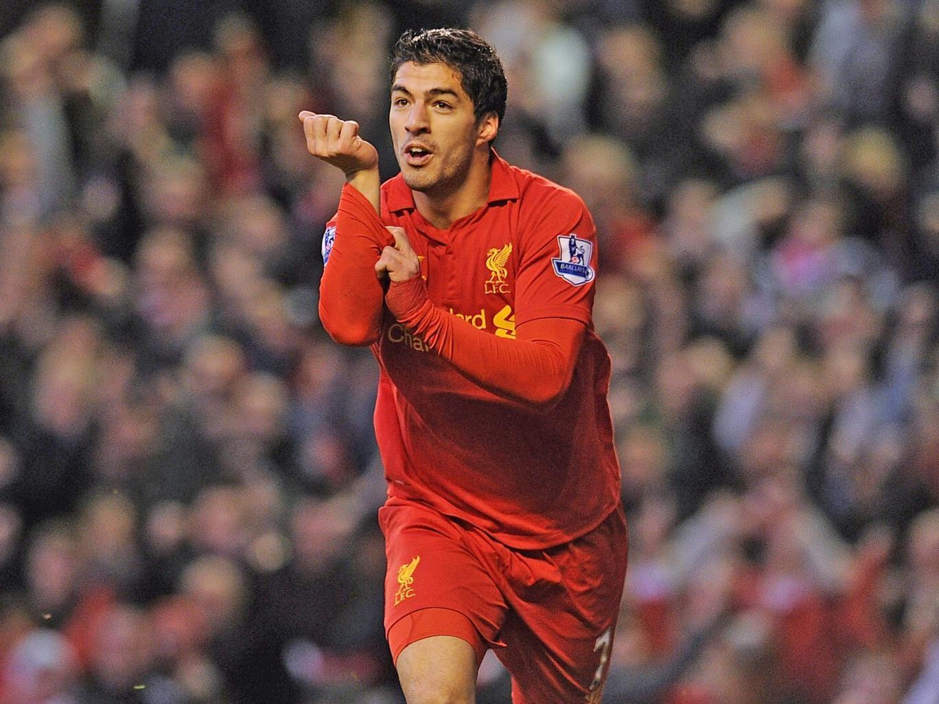Luis Suarez celebrates scoring for Liverpool