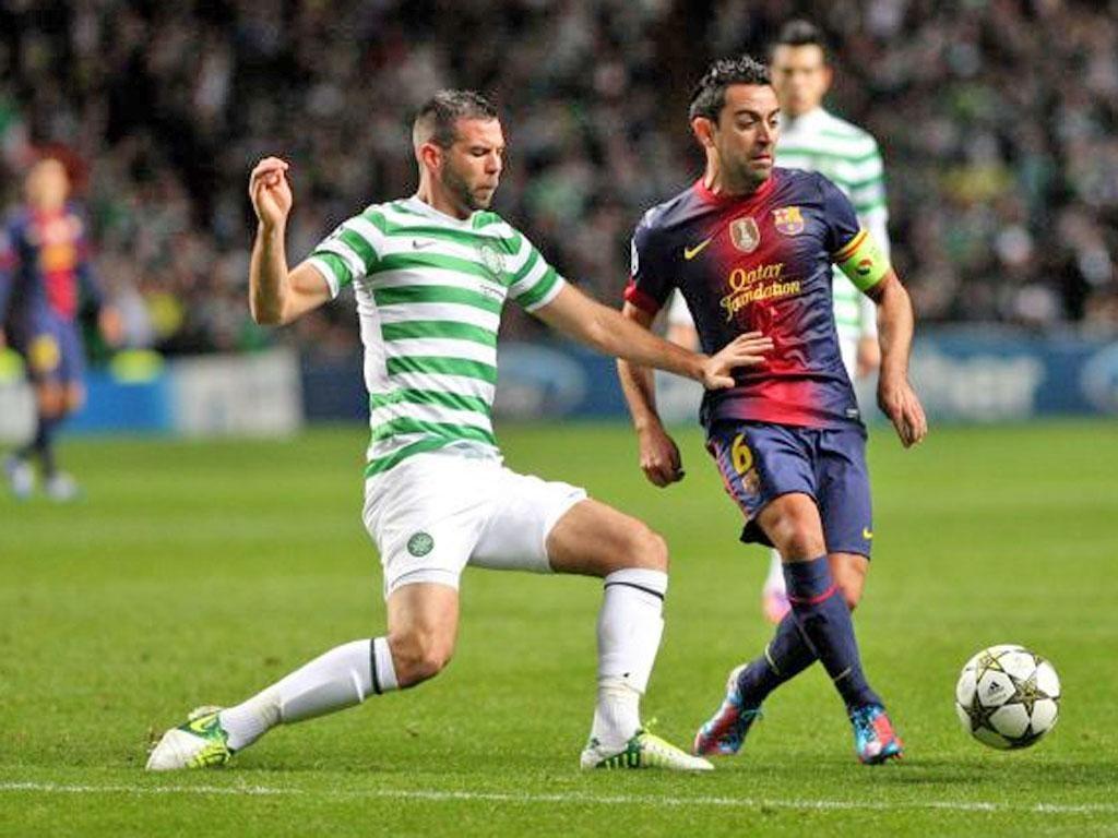 Joe Ledley, left, challenges Barcelona's Xavi in last month's win
