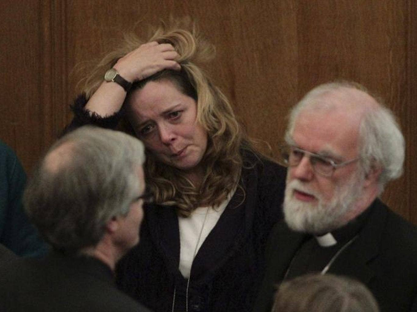 Canon Paula Gooder looks on alongside Rowan Williams, the outgoing Archbishop of Canterbury, after the decision is announced