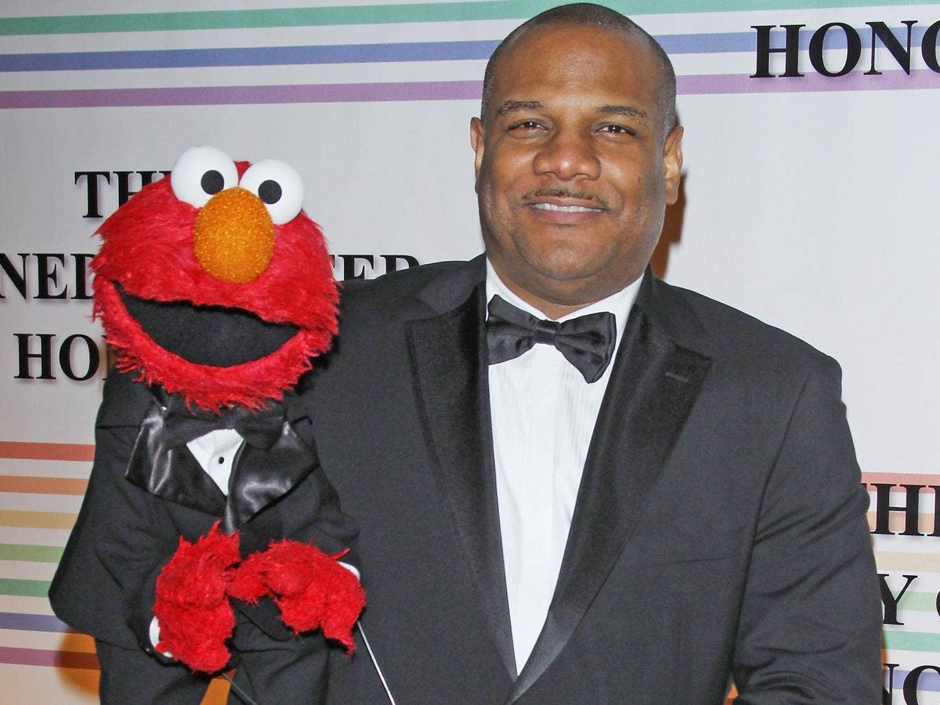 Kevin Clash poses with Elmo