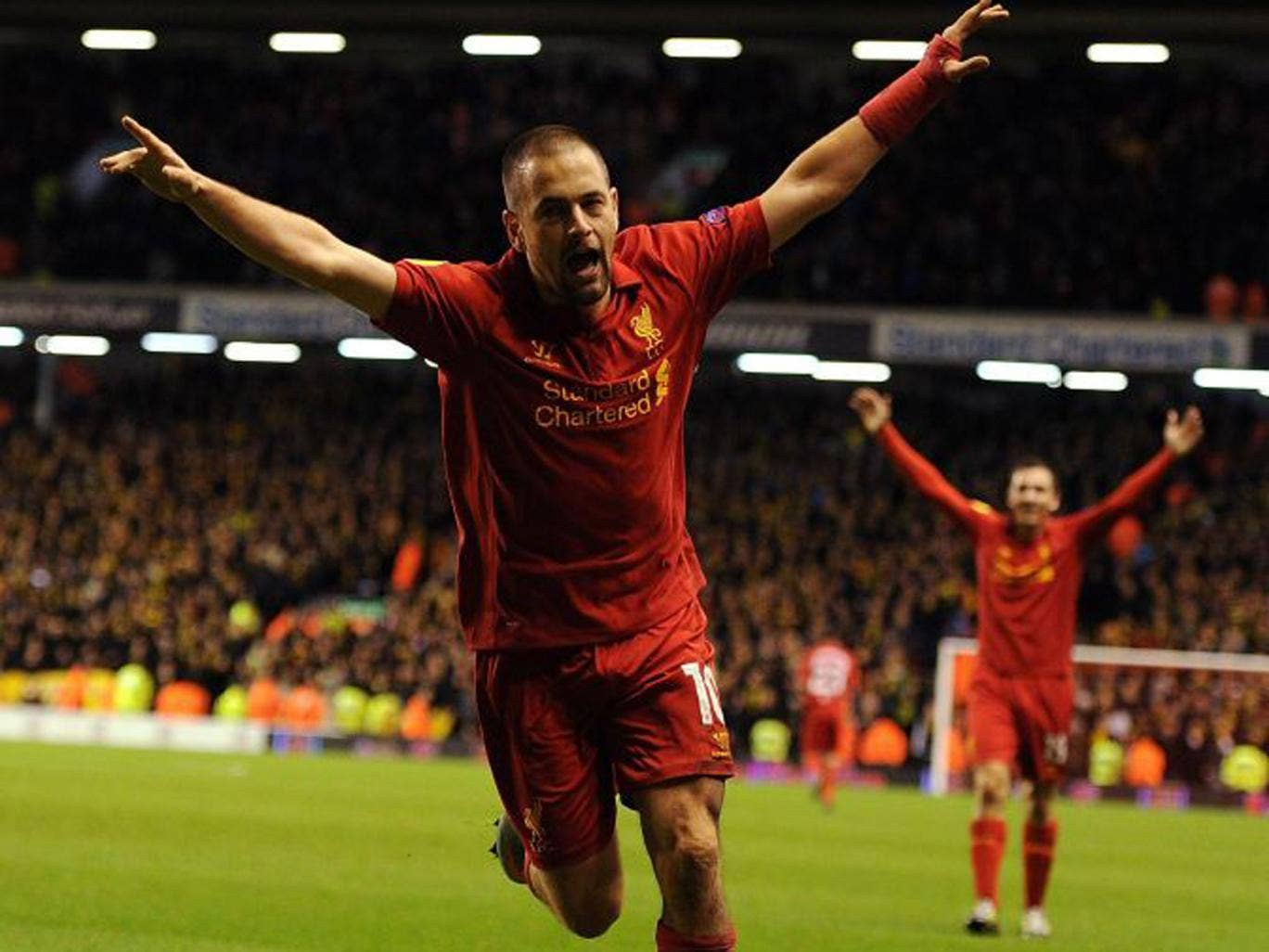 Joe Cole celebrates his first goal for Liverpool since April 2011