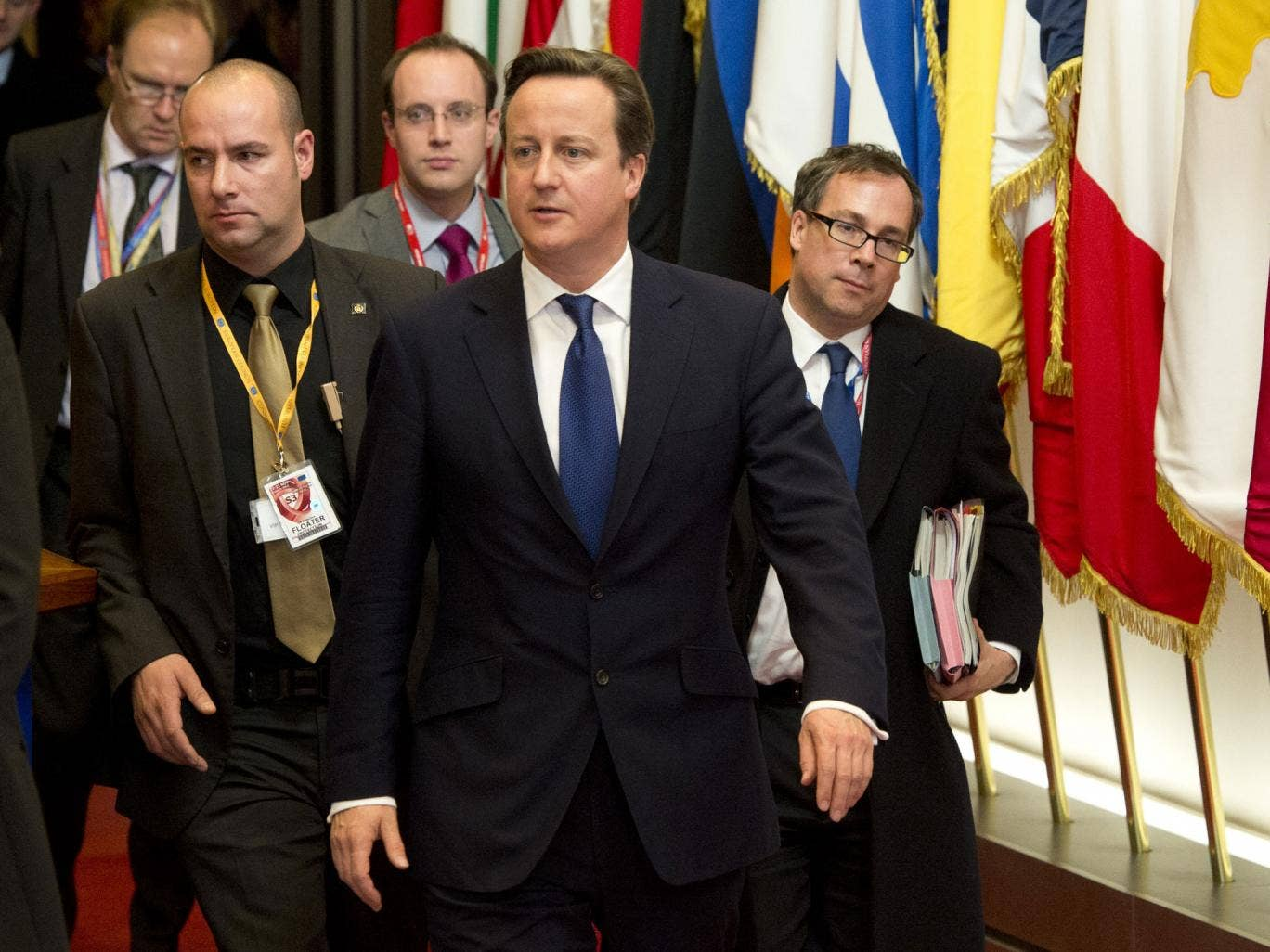 David Cameron, centre, departs after the EU summit in Brussels
