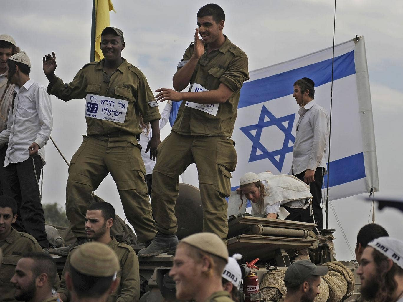 Israeli soldiers in cheerful mood before leaving a deployment area near the Gaza Strip