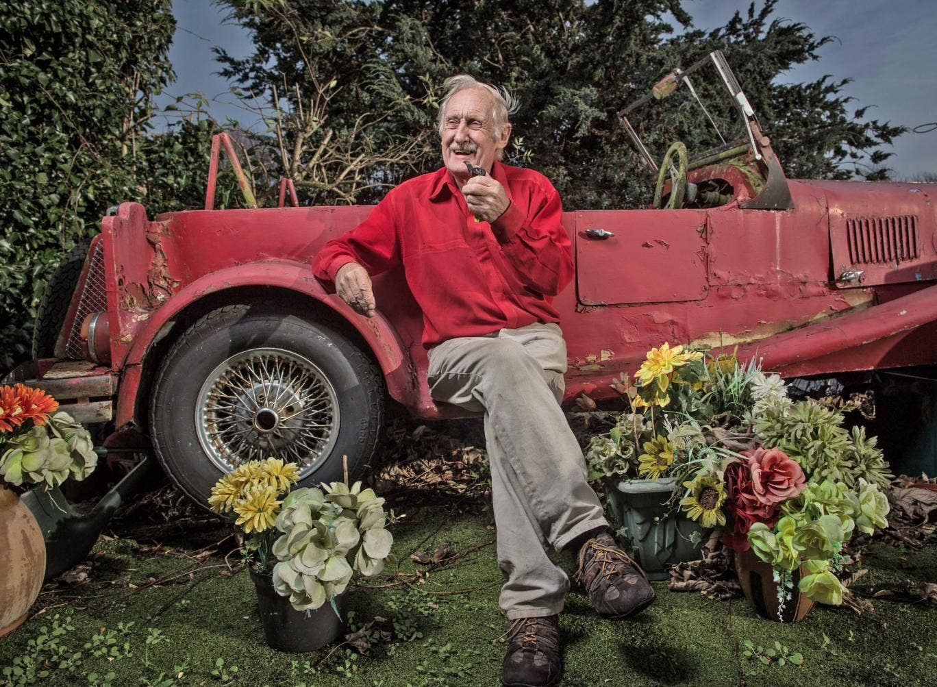 Driven eccentric: Trevor Baylis sits in his garden with his self-modified Ford Cortina, which has about six inches on the clock