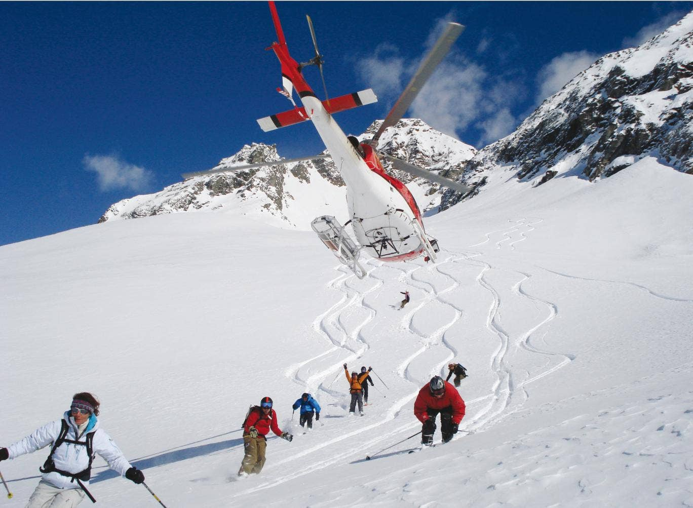 New tracks: heliskiers take to the slopes in the Italian Alps