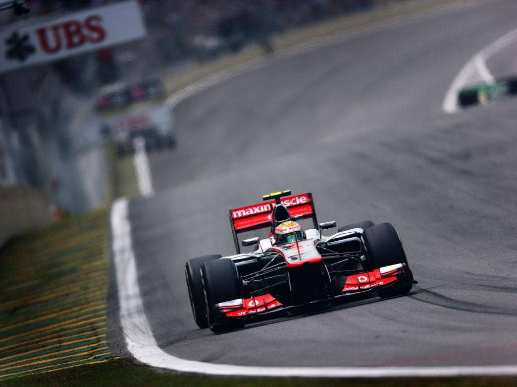 Lewis Hamilton of Great Britain and McLaren drives on his way to finishing first during qualifying for the Brazilian Formula One Grand Prix