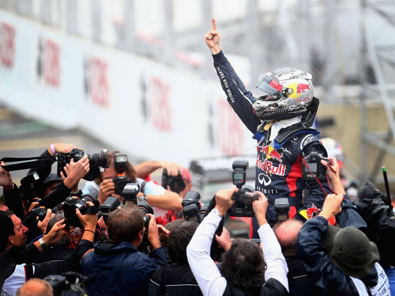 Sebastian Vettel of Germany and Red Bull Racing celebrates in parc ferme as he finishes in sixth position and clinches the drivers world championship during the Brazilian Formula One Grand Prix