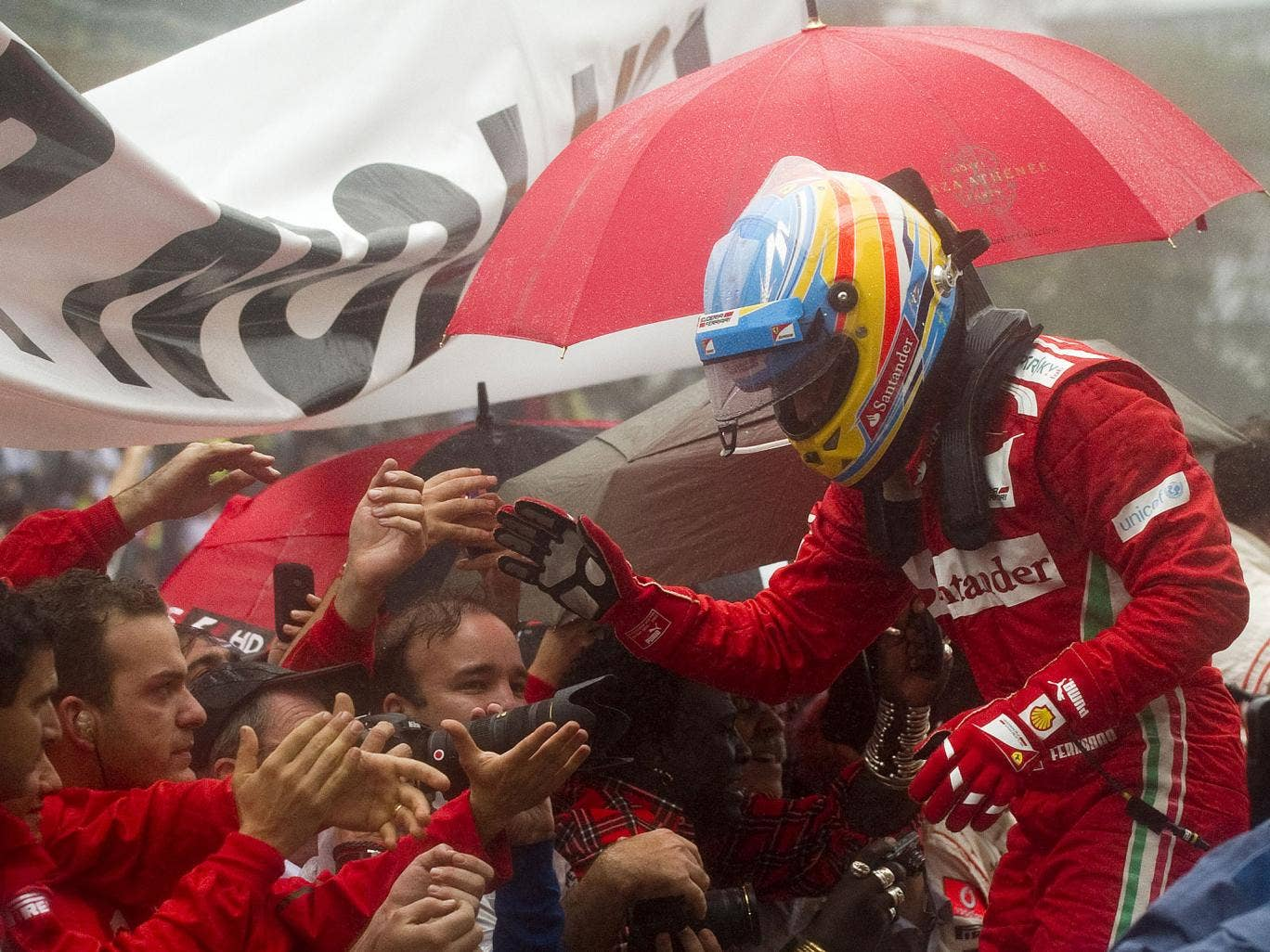 Spanish Formula One driver Fernando Alonso with the Ferrari team after missing out on another championship title in the last race of the season