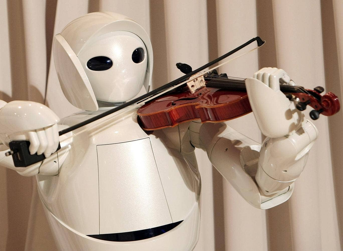 Toyota's violin-playing robot plays at Tokyo's Universal Design Showcase in 2007