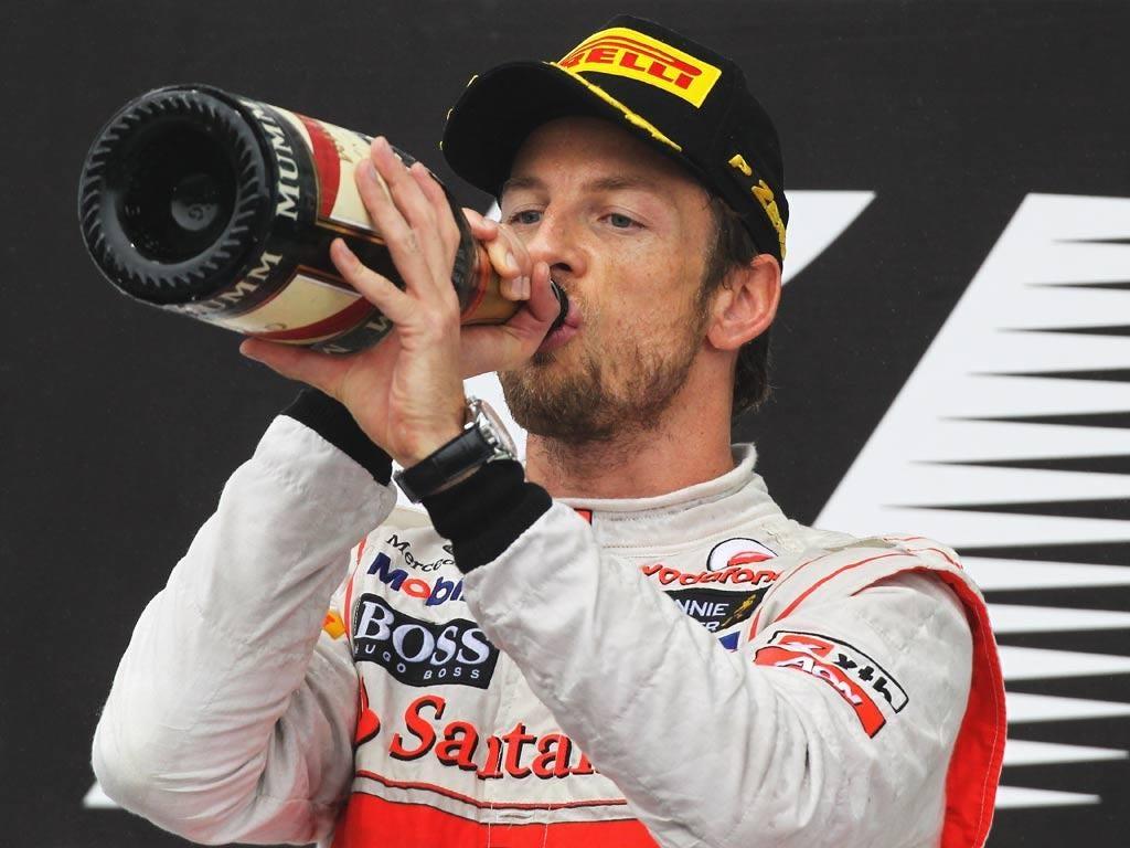 Jenson Button celebrates victory in Brazil