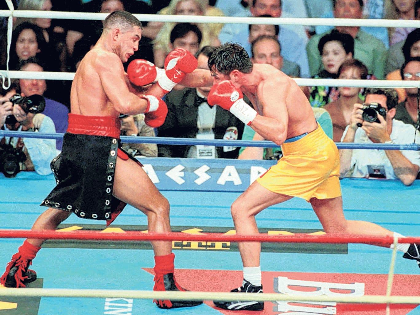 Camacho, above left, fights Oscar De La Hoya in 1997